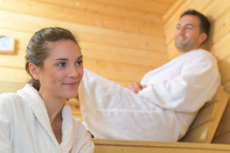 loving couple relaxing in the sauna