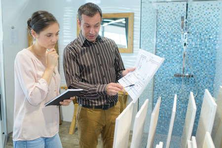 couple choosing the tiles Stock Photo