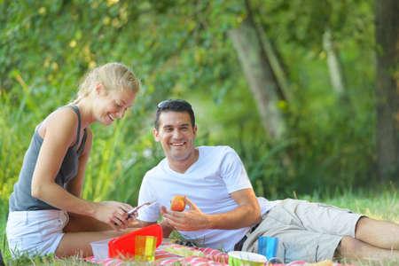 couple having picnic man holding apple