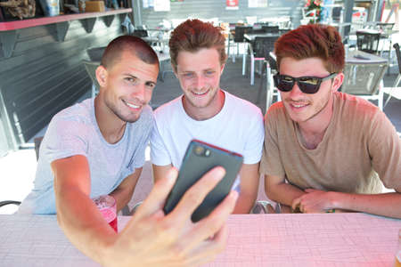 group of young tourist friends taking selfie at the bar Stock Photo
