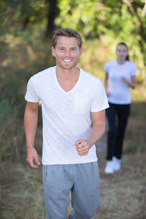 couple jogging and running outdoors
