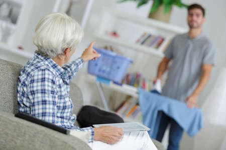 male nurse assisting senior woman at health club