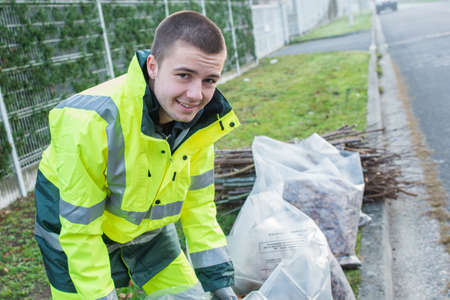 young worker collects debris