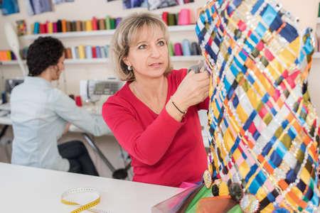 two dressmakers in their workshop Stockfoto