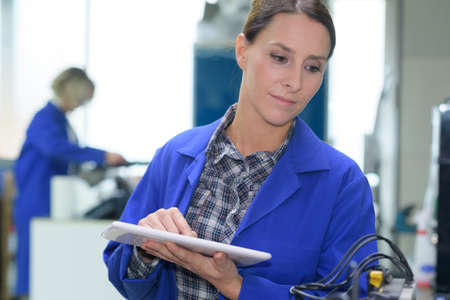 female engineer holding tablet computer