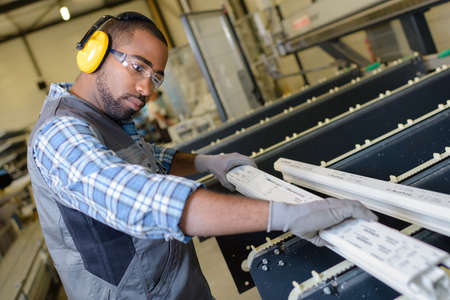 portrait of worker near metalworking machine Фото со стока