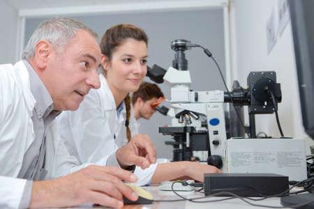 happy teacher and laboratory students