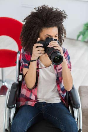 female photographer in wheelchair