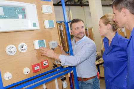 emergency buttons installer apprentices Stock Photo