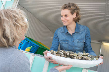 the oyster seller Stock Photo