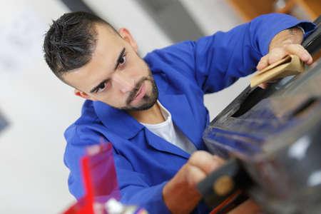 parts assembler at work