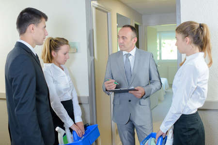 supervisor checking his cleaning checklist team tasks
