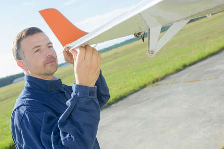 aircraft technician inspecting the wing part