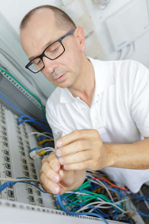 man in a server room Stock Photo