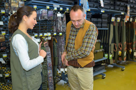 male customer examining coats in a store Stock Photo