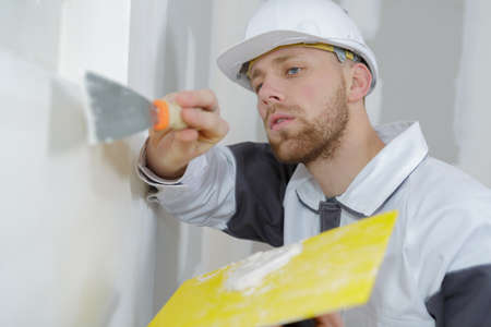 closeup of plasterer working on wall Stock Photo