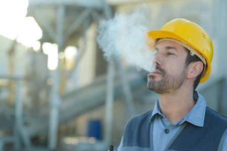 builder worker with a cigarette smoke break Stock Photo