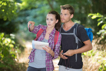 Couple orienteering, pointing into distance