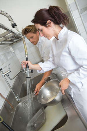 Chefs at sink washing up