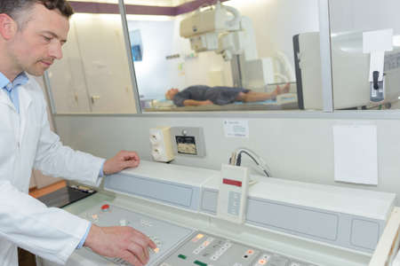male doctor using mri machine at the hospital