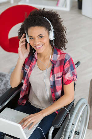 handicaped young woman relaxing with her laptop