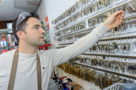 professional with different types of keys in locksmith