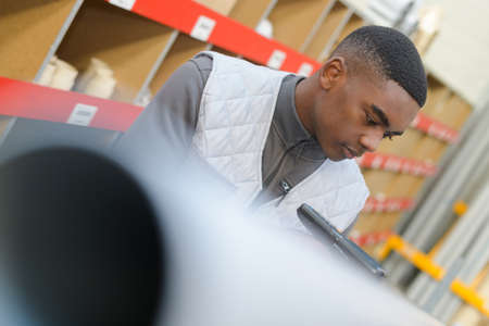 worker using a scanner in warehouse