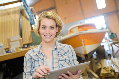 worker with tablet smiling in a warehouse