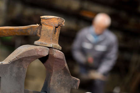 Closeup of sledgehammer in blacksmiths workshop