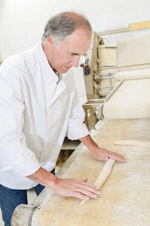 Man rolling dough