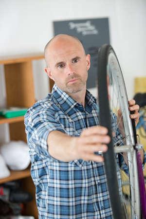 bicycle mechanic works in workshop