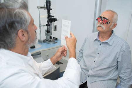 senior man having his eyes examined by an eye doctor