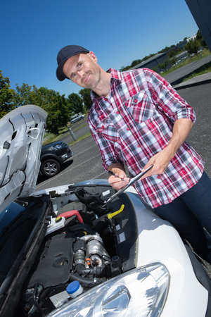 handsome man checking car engine Stock Photo