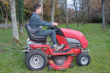young gardener operating a garden tractor