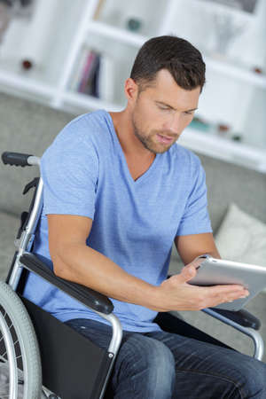 smiling disabled guy reading emails