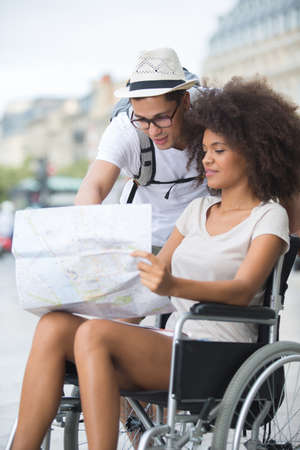 handicapped woman in wheelchair and boyfriend on holidays