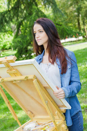 cute female painter outdoor Stock Photo