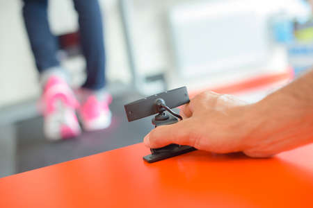 foot of woman running on treadmill in gym Stock Photo