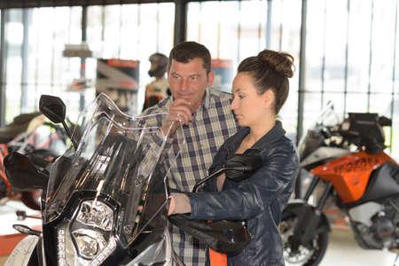 Couple in motorcycle showroom