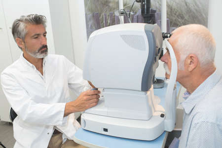elderly man with glaucoma at the optician for optical examination