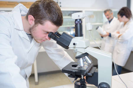young doctor scientist with microscope Stock Photo