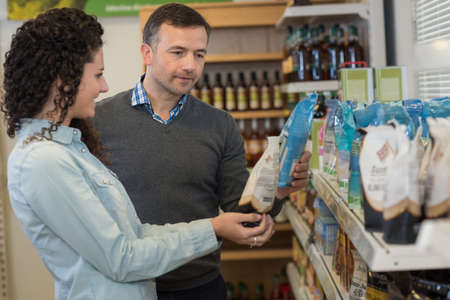 buyer in shop buys coffee with assistant help