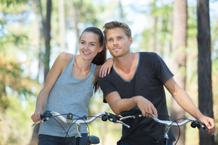 couple on bicycles rides on the road Stock Photo