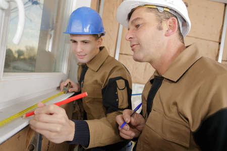 two laborers at work Stock Photo