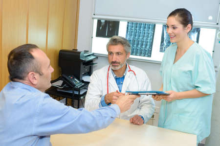 doctor with nurse and patient Stock Photo