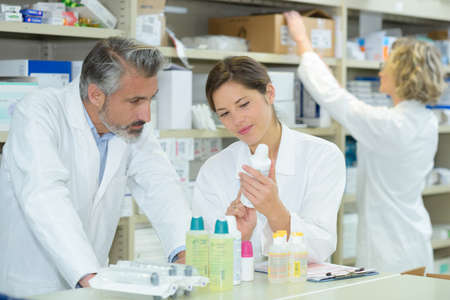 pharmacist inspecting the products Stock Photo