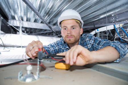 a busy electrician Stock Photo