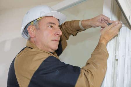 builder working on blinders