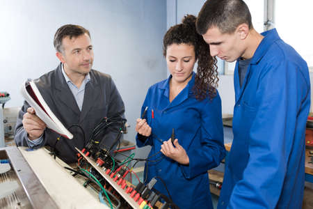 students of training college with electronic components