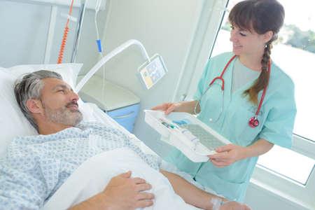 female nurse caring man at the hospital
